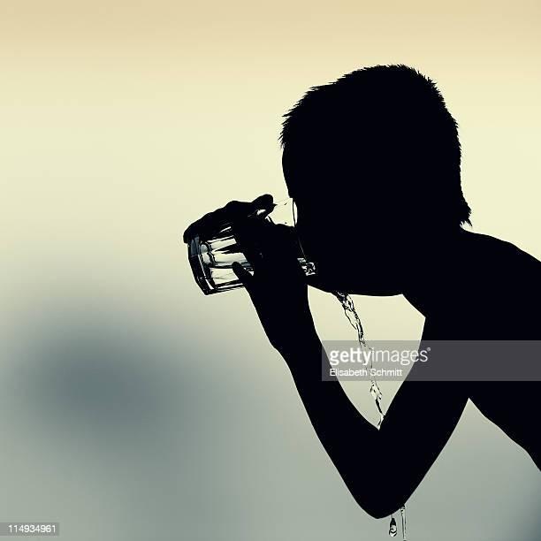 Silhouette of boy, drinking water