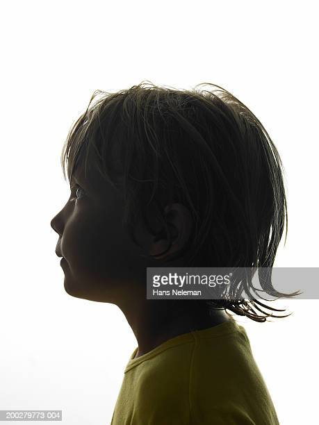Silhouette of boy (4-6), side view, close-up