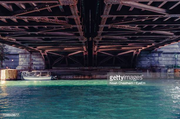silhouette of bridge over water - chicago illinois stock pictures, royalty-free photos & images