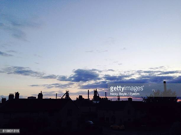 silhouette of building against sky during sunset - port talbot stock pictures, royalty-free photos & images