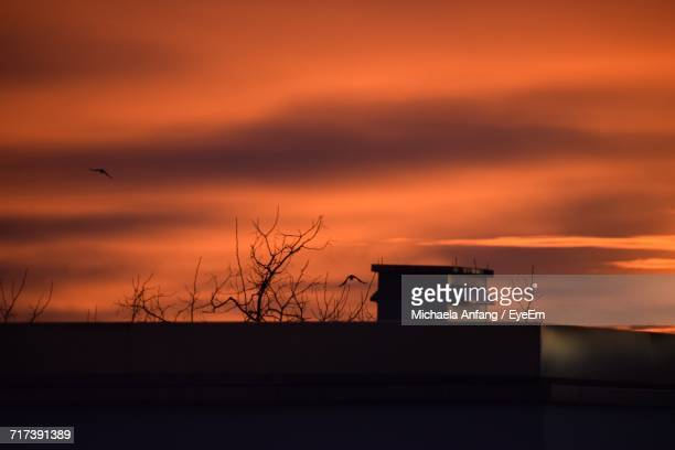 silhouette of building against sunset sky - anfang stock pictures, royalty-free photos & images