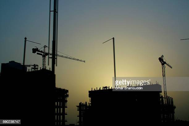 silhouette of building in construction in dubai - omar shamsuddin stock pictures, royalty-free photos & images