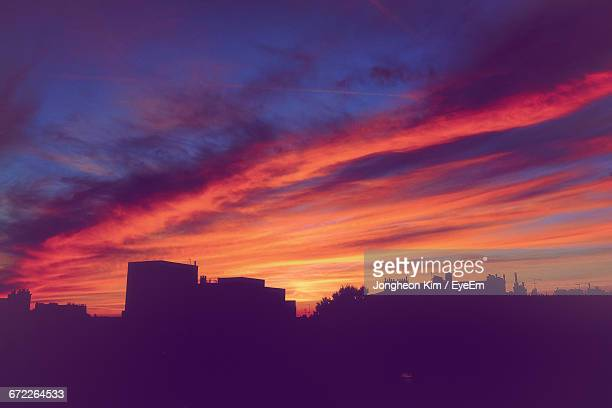 Silhouette Of Buildings Against Dramatic Sky