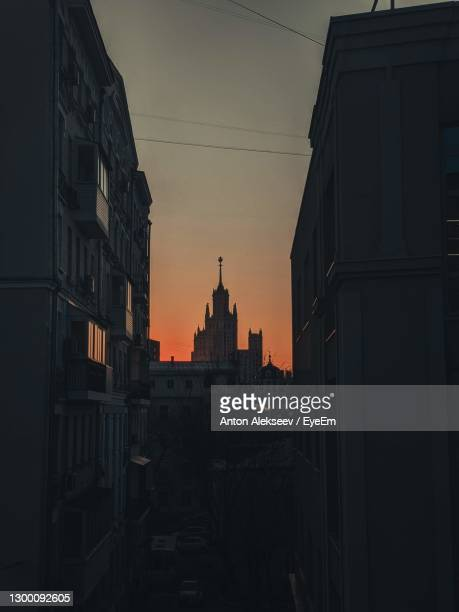 silhouette of buildings against sky during sunset - moscow russia stock pictures, royalty-free photos & images