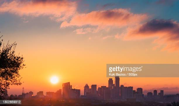 silhouette of buildings against sky during sunset,austin,texas,united states,usa - austin texas stock pictures, royalty-free photos & images