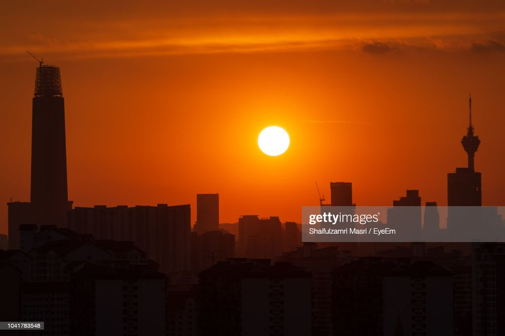 Silhouette Of Buildings At Sunset : Stock Photo