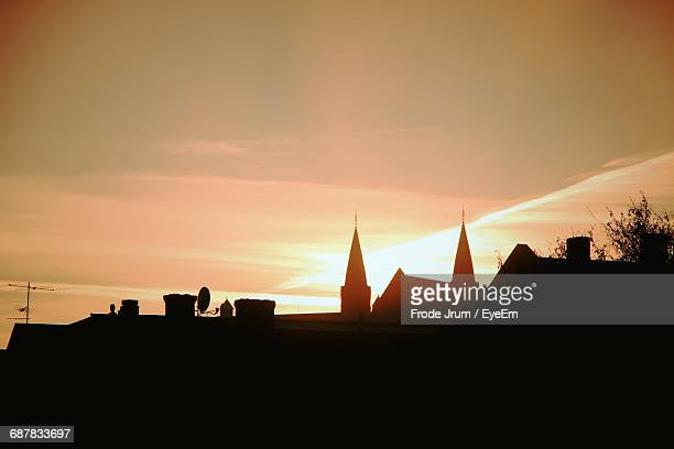 silhouette of buildings at sunset - トロンハイム ストックフォトと画像
