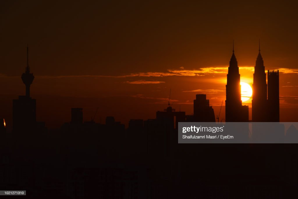 Silhouette Of Buildings In City During Sunset : Stock Photo
