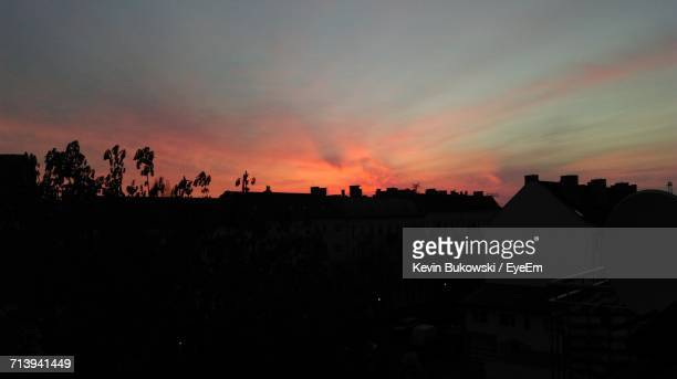 Silhouette Of Built Structures Against Dramatic Sky
