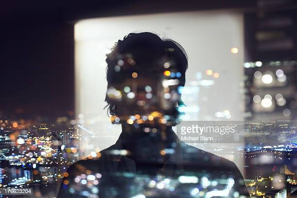 silhouette of business man against city