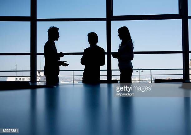 Silhouette of business men and woman
