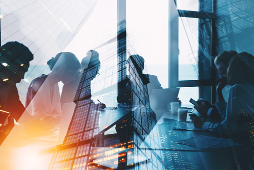 Silhouette of business people work together in office. Concept of teamwork and partnership. double exposure with light effects 1136530201