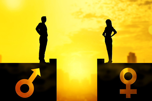 Silhouette of businessman and businesswoman standing on the rooftop with same height 1126075702