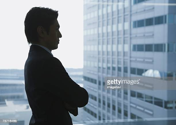 Silhouette of businessman near by the window