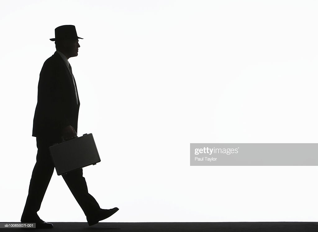 Silhouette Of Businessman Walking With Briefcase Side View ...