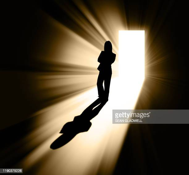 silhouette of businesswoman in doorway - victim stock pictures, royalty-free photos & images