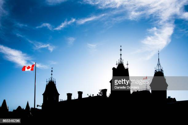 silhouette of canada's parliament buildings - politics stock pictures, royalty-free photos & images