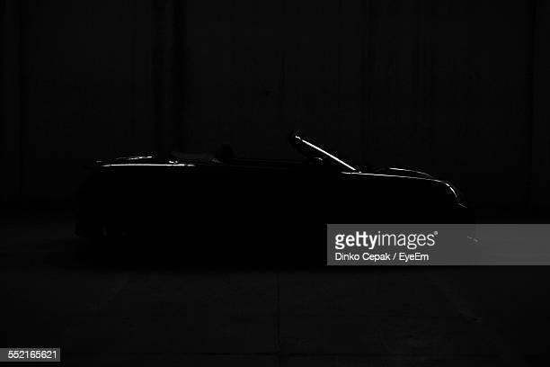 Silhouette Of Car At Night