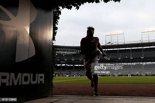 A silhouette of Carlos Santana of the Cleveland Indians jogging into the outfield batting cage prior to Game 4 of the 2016 World Series against the...
