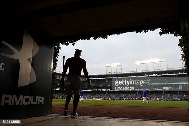 A silhouette of Carlos Santana of the Cleveland Indians leaving the outfield batting cage prior to Game 4 of the 2016 World Series against the...