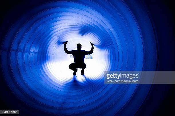 silhouette of caucasian man in tunnel - claustrophobia stock photos and pictures