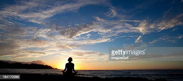 Silhouette of Caucasian Woman Doing Yoga in Hawaii