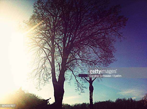 silhouette of christ on cross against sky - death and resurrection of jesus stock photos and pictures