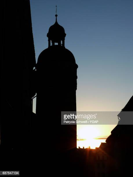 Silhouette of church at sunset