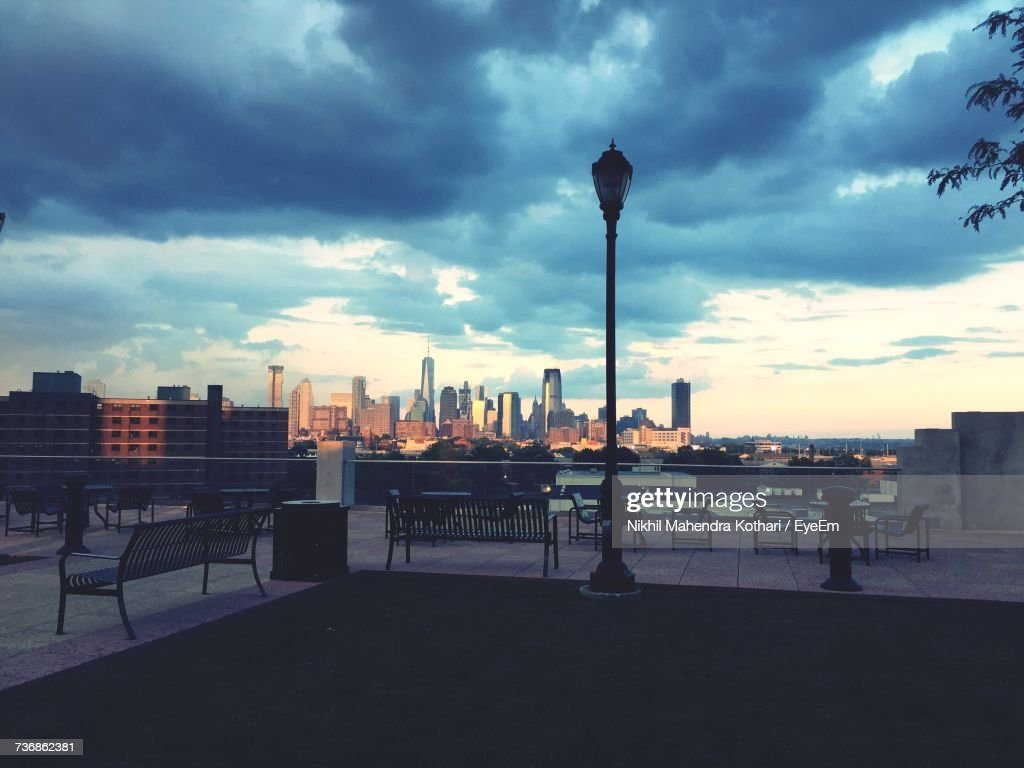 Silhouette Of City Against Cloudy Sky : Stock Photo