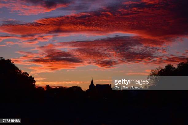 silhouette of city against dramatic sky - lowell massachusetts stock pictures, royalty-free photos & images