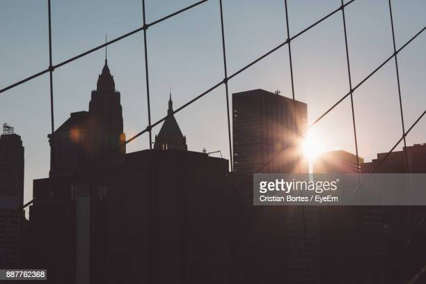 Silhouette Of City Against Sky During Sunset