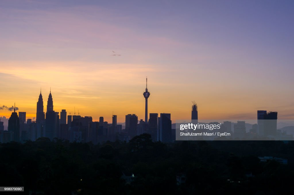 Silhouette Of City Against Sky During Sunset : Stock Photo