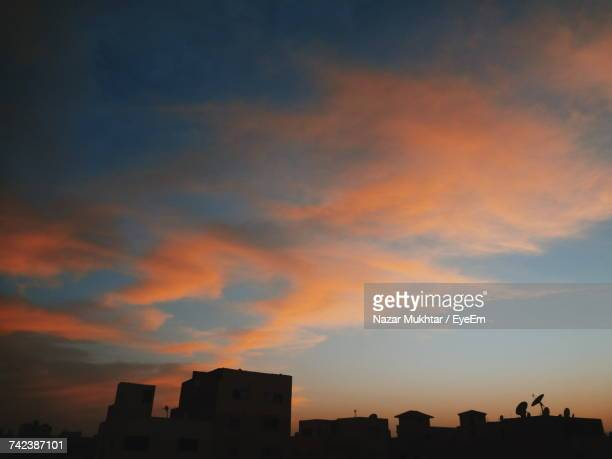silhouette of city at sunset - nazar stock photos and pictures