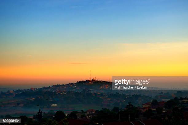 silhouette of city during sunset - kampala stock-fotos und bilder