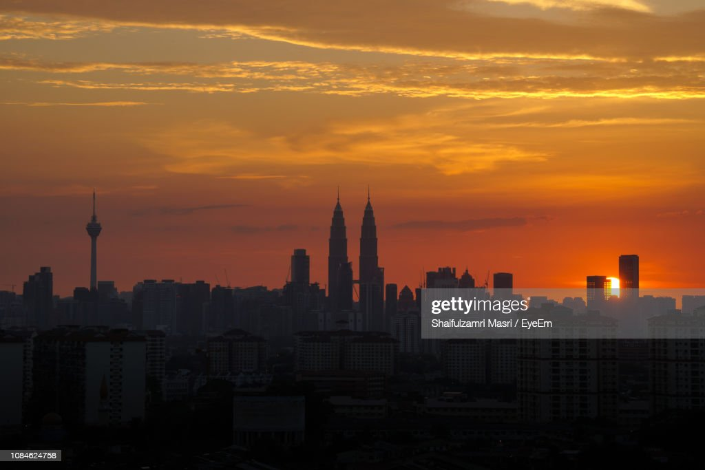 Silhouette Of Cityscape At Sunset : Stock Photo