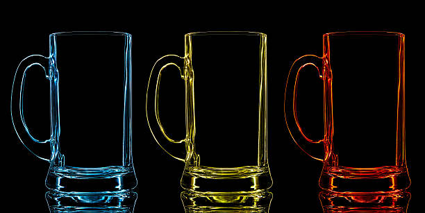 Silhouette of color beer glass on black background