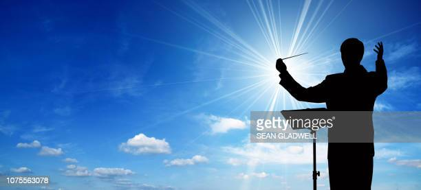 silhouette of conductor - conductor's baton stock photos and pictures