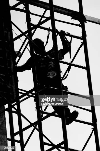 Silhouette of Construction Worker on Scaffolding
