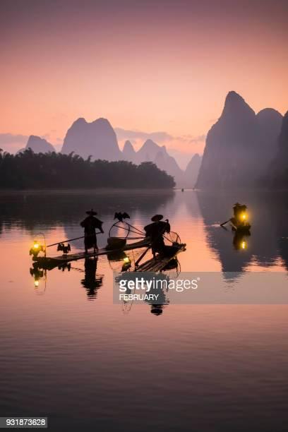 Silhouette of Cormorant fishermen at Guilin.