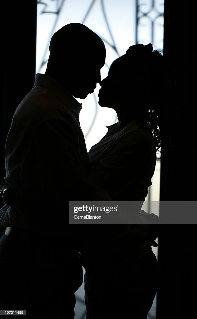 Silhouette of couple gazing closely at each other : Stock Photo