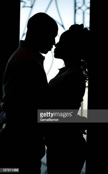 Silhouette of couple gazing closely at each other