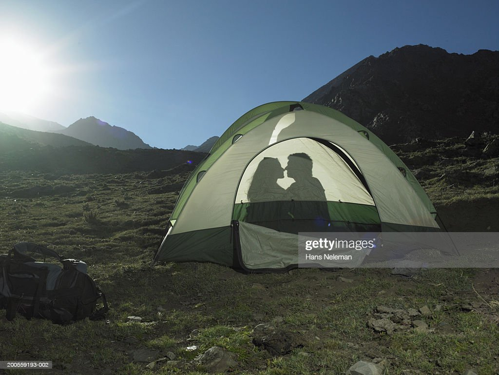 Silhouette of couple in tent on mountain  Stock Photo & Silhouette Of Couple In Tent On Mountain Stock Photo | Getty Images