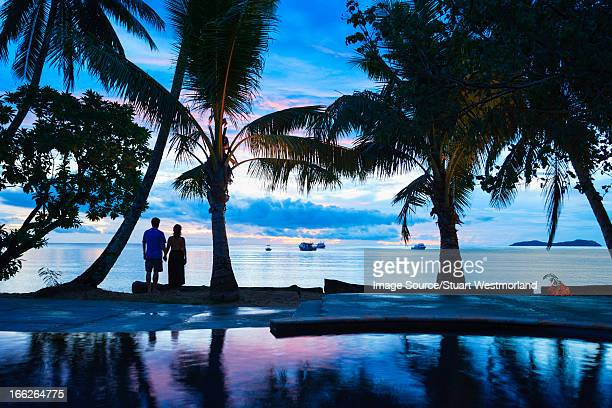 Silhouette of couple on tropical beach