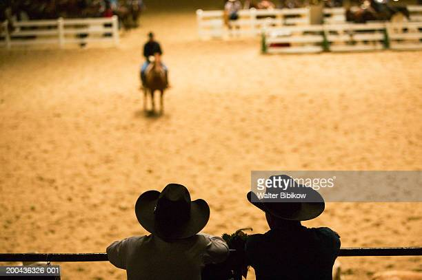silhouette of cowboys at indoor rodeo - fort worth stock pictures, royalty-free photos & images