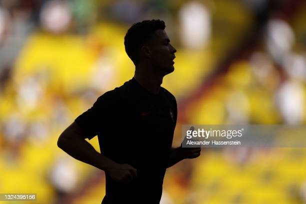 Silhouette of Cristiano Ronaldo of Portugal during the warm up prior to the UEFA Euro 2020 Championship Group F match between Portugal and Germany at...