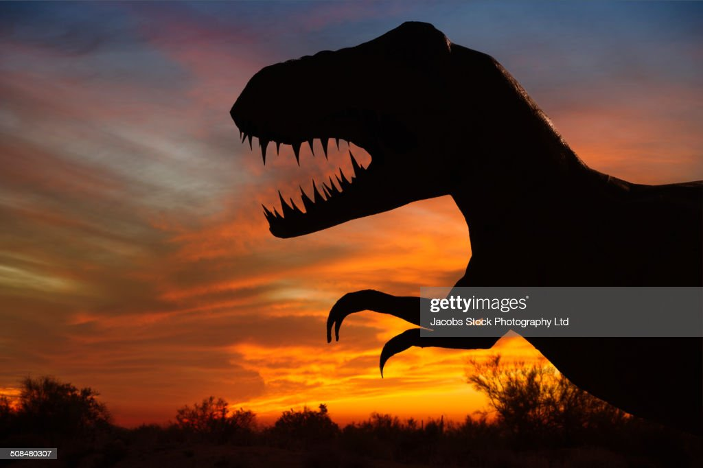Silhouette of dinosaur sculpture at sunset, Moab, Utah, USA : Stock Photo