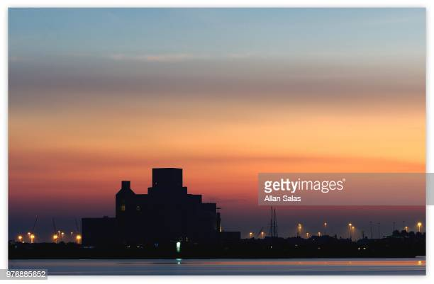 silhouette of distant building, doha, qatar - doha stock pictures, royalty-free photos & images