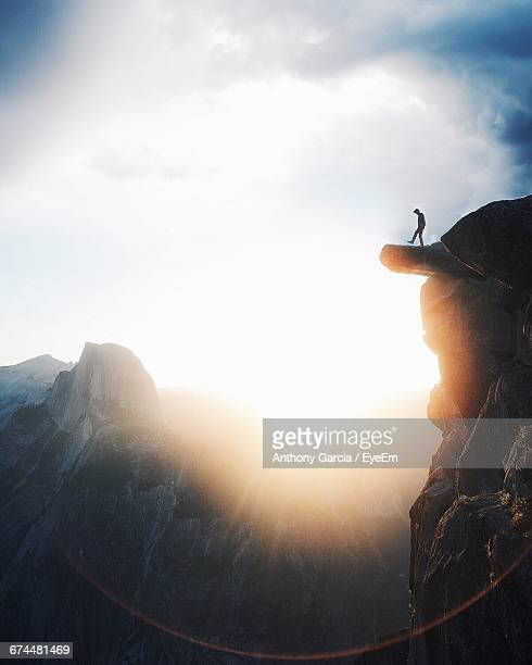 Silhouette Of Distant Man On Top Of The Mountain