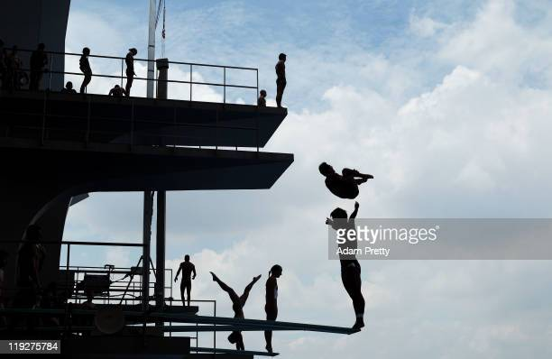 A silhouette of divers during a practice session prior to the Men's 1m Springboard preliminary round during Day One of the 14th FINA World...