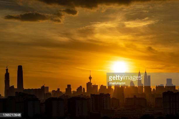 silhouette of downtown kuala lumpur - shaifulzamri stock pictures, royalty-free photos & images